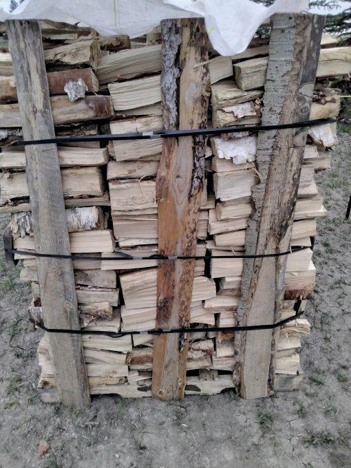 Birch firewood stack side view